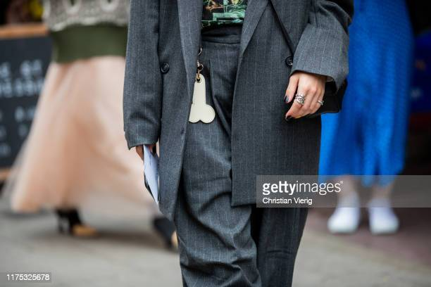 Guest is seen wearing accessoire outside JW Anderson during London Fashion Week September 2019 on September 16, 2019 in London, England.