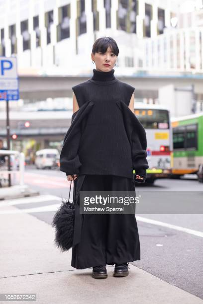 A guest is seen wearing allblack outfit including knit sweater wideleg pants and fur bag during the Amazon Fashion Week TOKYO 2019 S/S on October 20...