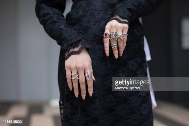 A guest is seen wearing allblack outfit with hat and veil white pearl necklace and silver rings during the Amazon Fashion Week TOKYO 2019 A/W on...