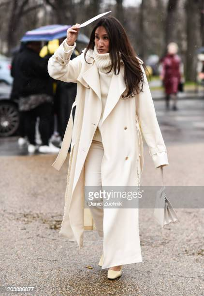 Guest is seen wearing an all white outfit outside the Maison Margiela show during Paris Fashion Week: AW20 on February 26, 2020 in Paris, France.
