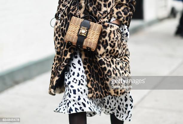 A guest is seen wearing an animal print coat and dress at the Tibi show during New York Fashion Week Women's Fall/Winter 2017 on February 11 2017 in...