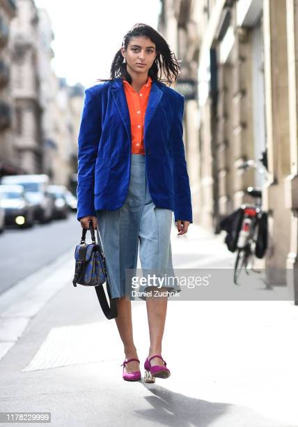 Guest is seen wearing an APC blue jacket, orange top and blue jean skirt with purple heels outside the APC show during Paris Fashion Week SS20 on...
