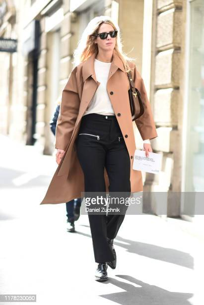 Guest is seen wearing an APC coat outside the APC show during Paris Fashion Week SS20 on September 30, 2019 in Paris, France.