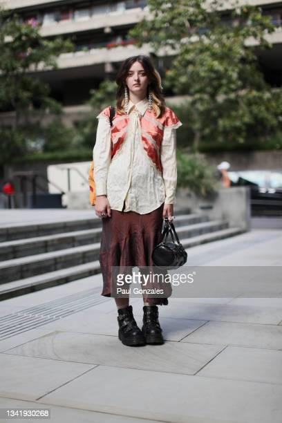 Guest is seen wearing an Ecru Blouse at Pronounce during London Fashion Week September 2021 on September 21, 2021 in London, England.