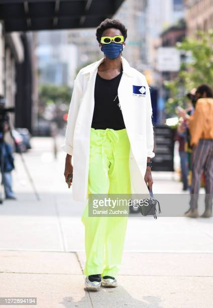 Guest is seen wearing an Empty Gallery coat, black top, green pants and green sunglasses outside the Studio 189 show during New York Fashion Week...