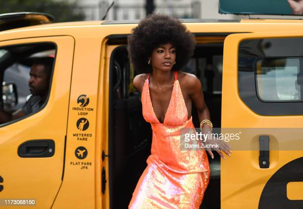 A guest is seen wearing an orange shiny dress outside the Area show during New York Fashion Week S/S20 on September 07 2019 in New York City