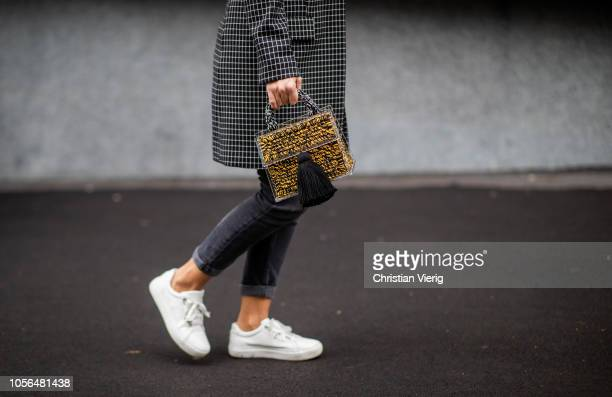 A guest is seen wearing bag with animal print during MercedesBenz Tbilisi Fashion Week on November 2 2018 in Tbilisi Georgia
