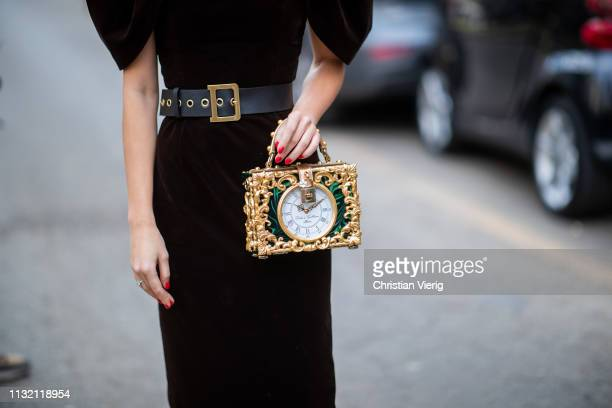 A guest is seen wearing bag with clock outside Dolce Gabbana on Day 5 Milan Fashion Week Autumn/Winter 2019/20 on February 24 2019 in Milan Italy