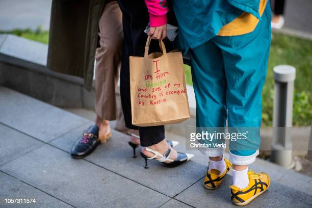A guest is seen wearing bag with political statement during MercedesBenz Tbilisi Fashion Week on November 4 2018 in Tbilisi Georgia