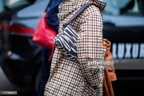 A guest is seen wearing bag with zebra print outside Baum und Pferdgarten during the Copenhagen Fashion Week Autumn/Winter 2019 Day 3 on January 31...
