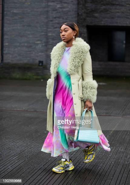 Guest is seen wearing batik dress, coat outside 7 Days on Day 1 during Copenhagen Fashion Week Autumn/Winter 2020 on January 28, 2020 in Copenhagen,...