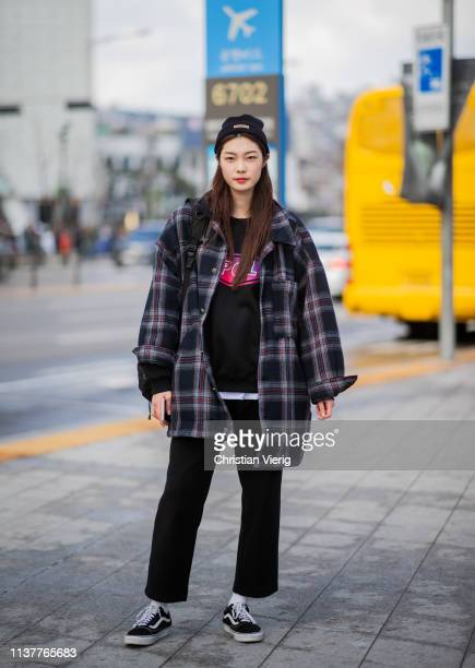 A guest is seen wearing beanie plaid jacket at the Hera Seoul Fashion Week 2019 F/W at Dongdaemun Design Plaza at Dongdaemun Design Plaza on March 23...