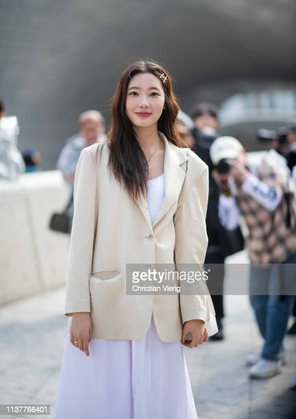 A guest is seen wearing beige blazer at the Hera Seoul Fashion Week 2019 F/W at Dongdaemun Design Plaza at Dongdaemun Design Plaza on March 23 2019...