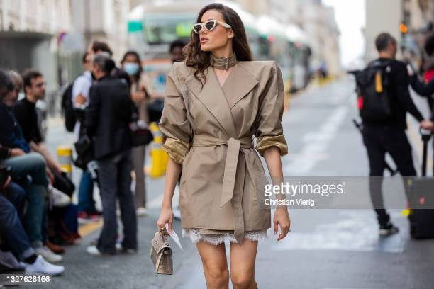 Guest is seen wearing beige blazer jacket, skirt, heels, Hermes bag outside Zuhair Murad on July 07, 2021 in Paris, France.