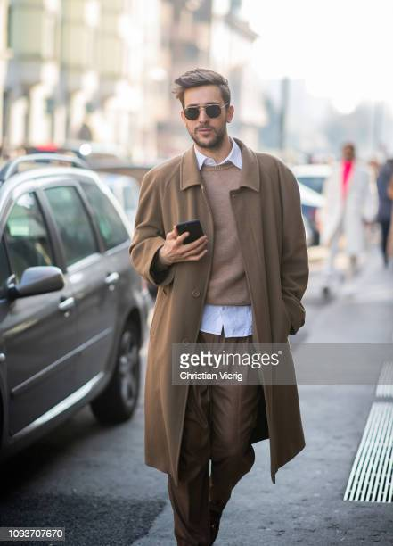 A guest is seen wearing beige coat knit pants outside MSGM during Milan Menswear Fashion Week Autumn/Winter 2019/20 on January 13 2019 in Milan Italy