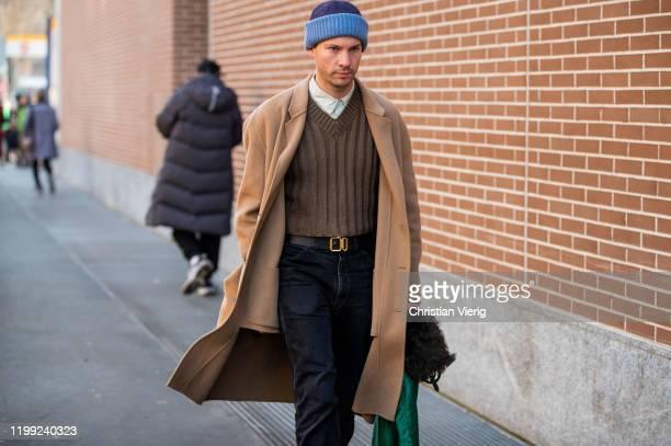 Guest is seen wearing beige coat outside Fendi during Milan Fashion Week Fall/Winter 2020/2021 on January 13, 2020 in Milan, Italy.