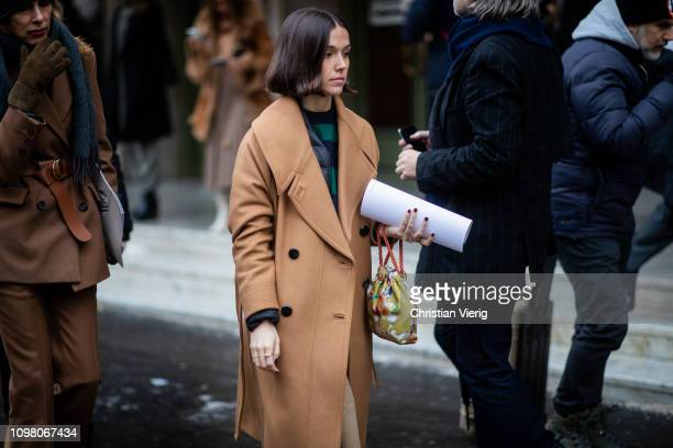 A guest is seen wearing beige coat outside Stephane Rolland during Haute Couture Spring Summer 2019 Day Two on January 22 2019 in Paris France