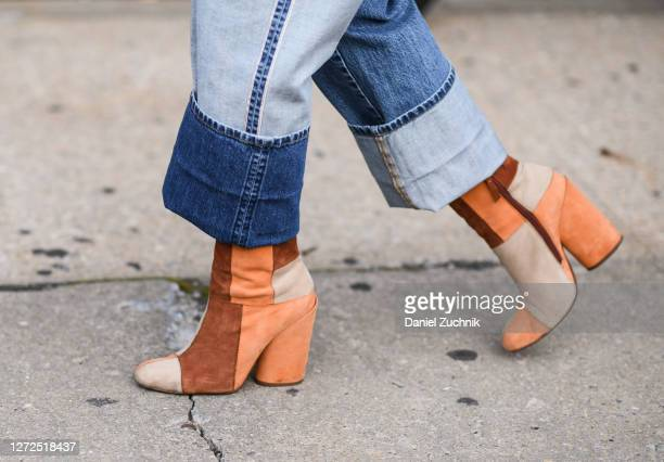 Guest is seen wearing beige, color-blocked boots outside the Monse show during New York Fashion Week S/S21 on September 14, 2020 in New York City.