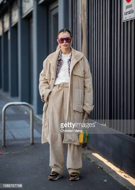 A guest is seen wearing beige corduroy coat and pants outside MSGM during Milan Menswear Fashion Week Autumn/Winter 2019/20 on January 13 2019 in...
