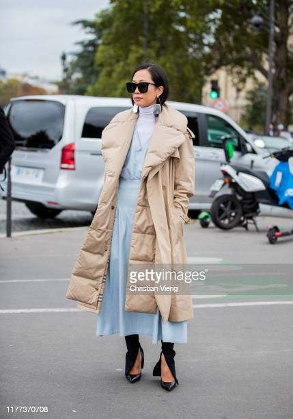 A guest is seen wearing beige down feather coat outside Y/Project during Paris Fashion Week Womenswear Spring Summer 2020 on September 26 2019 in...
