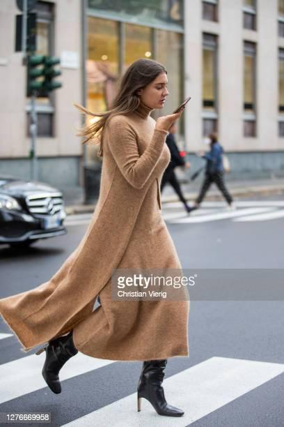 Guest is seen wearing beige dress outside Boss during the Milan Women's Fashion Week on September 25, 2020 in Milan, Italy.