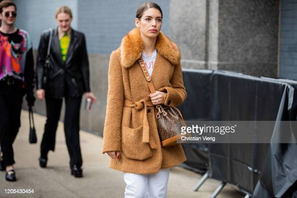 Guest is seen wearing beige jacket, Fendi bag outside Jonathan Simkhai during New York Fashion Week Fall / Winter on February 10, 2020 in New York...