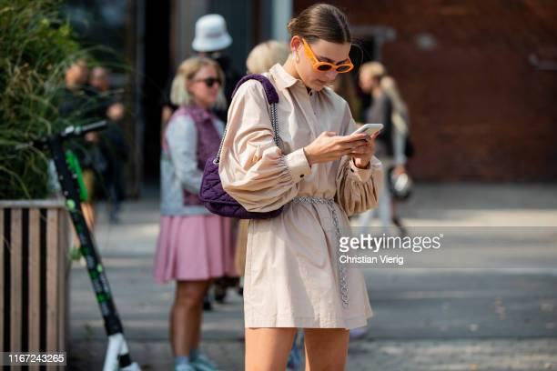 Guest is seen wearing beige jacket, purple Chanel bag outside Munthe during Copenhagen Fashion Week Spring/Summer 2020 on August 07, 2019 in...