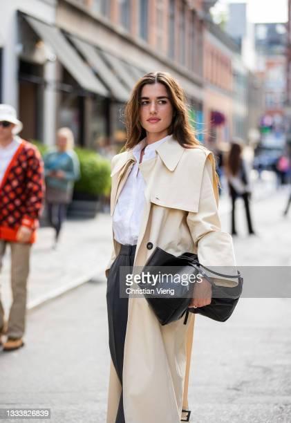 Guest is seen wearing beige outside By Malene Birger on August 11, 2021 in Copenhagen, Denmark.