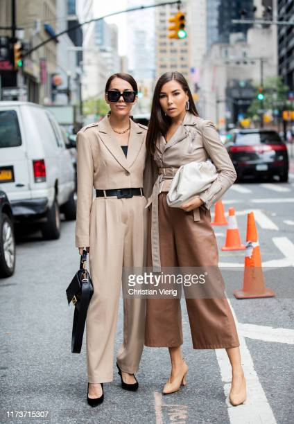A guest is seen wearing beige overall Fendi bag and a guest wearing brown pants outside Vera King during New York Fashion Week September 2019 on...