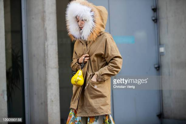 A guest is seen wearing beige parka outside Lanvin during Paris Fashion Week Menswear F/W 20202021 on January 19 2020 in Paris France