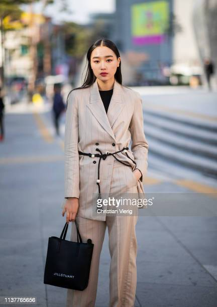 A guest is seen wearing beige suit at the Hera Seoul Fashion Week 2019 F/W at Dongdaemun Design Plaza at Dongdaemun Design Plaza on March 23 2019 in...