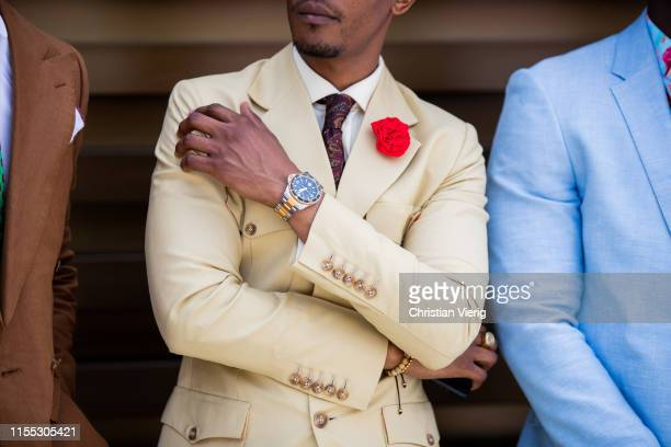 Guest is seen wearing beige suit, watch, tie during Pitti Immagine Uomo 96 on June 11, 2019 in Florence, Italy.