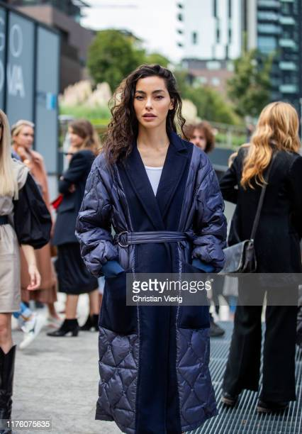 A guest is seen wearing belted two tone quilted coat outside the Sportmax show during Milan Fashion Week Spring/Summer 2020 on September 20 2019 in...