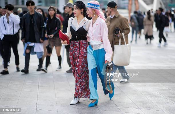 A guest is seen wearing beret belt skirt with floral print at the Hera Seoul Fashion Week 2019 F/W at Dongdaemun Design Plaza at Dongdaemun Design...