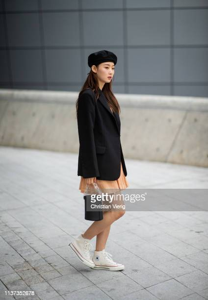 A guest is seen wearing beret blazer bag at the Hera Seoul Fashion Week 2019 F/W at Dongdaemun Design Plaza at Dongdaemun Design Plaza on March 21...