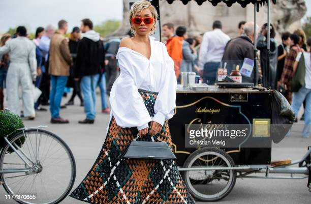 A guest is seen wearing black bag and plaid skirt white blouse outside Y/Project during Paris Fashion Week Womenswear Spring Summer 2020 on September...