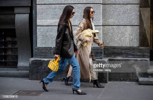 Guest is seen wearing black blazer denim jeans, yellow striped bag and a guest wearing camel Bottega twist bag, outside Philosophy during Milan...