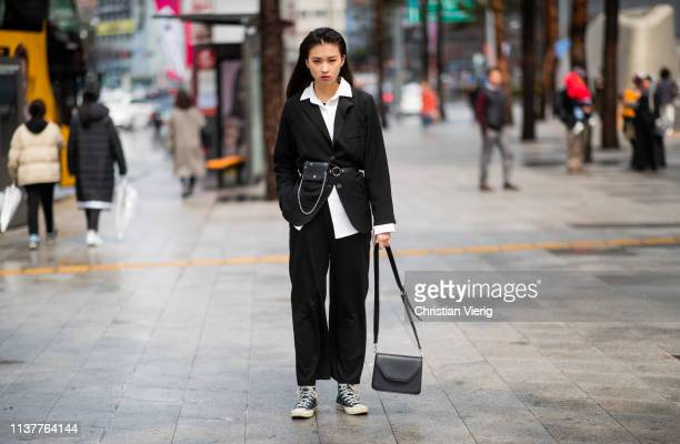 A guest is seen wearing black blazer fanny bag at the Hera Seoul Fashion Week 2019 F/W at Dongdaemun Design Plaza at Dongdaemun Design Plaza on March...