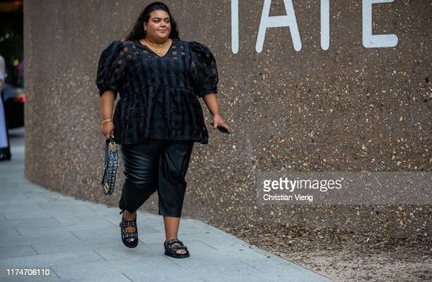 A guest is seen wearing black blouse black cropped pants sandals Dior bag outside Ports 1961 during London Fashion Week September 2019 on September...
