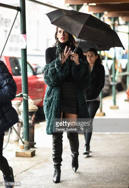 A guest is seen wearing black boots outside the Christian Cowan show during New York Fashion Week Women's A/W 2018 on February 10 2018 in New York...