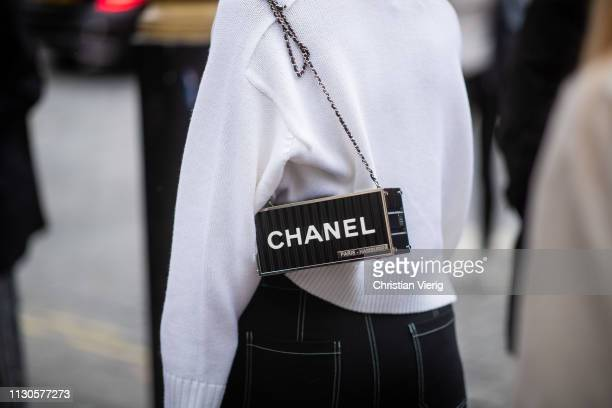 A guest is seen wearing black Chanel bag outside Erdem during London Fashion Week February 2019 on February 18 2019 in London England