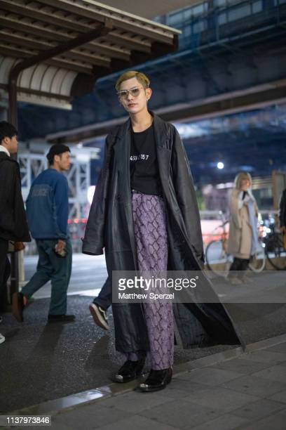 A guest is seen wearing black coat and shirt purple pattern pants during the Amazon Fashion Week TOKYO 2019 A/W on March 23 2019 in Tokyo Japan