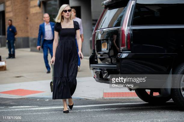 Guest is seen wearing black dress outside Gabriela Hearst during New York Fashion Week September 2019 on September 10, 2019 in New York City.