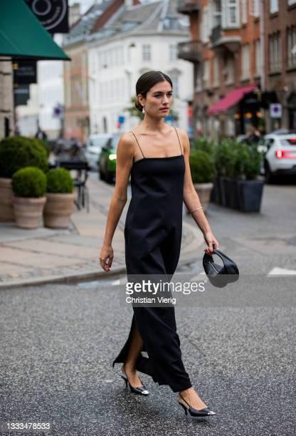 Guest is seen wearing black dress outside The Garment on August 10, 2021 in Copenhagen, Denmark.