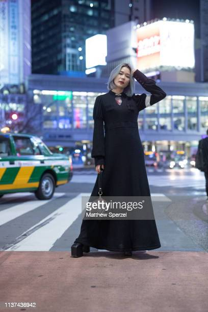 A guest is seen wearing black dress with grey bag during the Amazon Fashion Week TOKYO 2019 A/W on March 21 2019 in Tokyo Japan