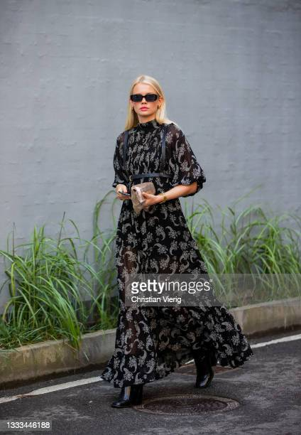 Guest is seen wearing black dress with print outside vision on August 10, 2021 in Copenhagen, Denmark.