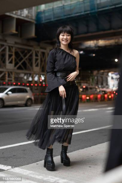 A guest is seen wearing black dress with sheer skirt during the Amazon Fashion Week TOKYO 2019 A/W on March 22 2019 in Tokyo Japan