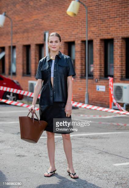A guest is seen wearing black leather button shirt skirt outside By Malene Birger during Copenhagen Fashion Week Spring/Summer 2020 on August 08 2019...