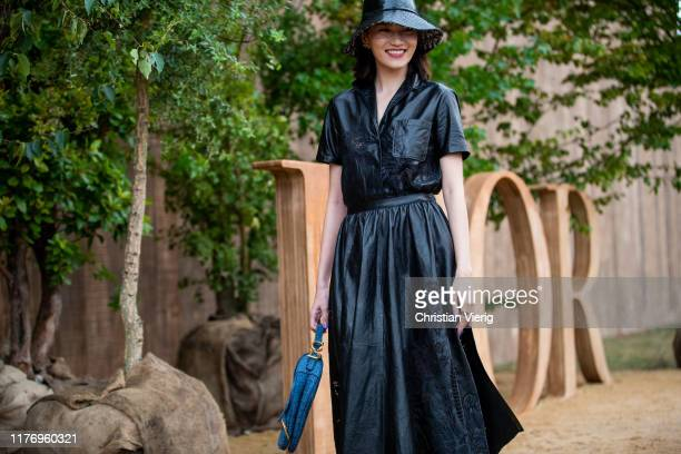 A guest is seen wearing black leather coat outside the Dior show during Paris Fashion Week Womenswear Spring Summer 2020 on September 24 2019 in...