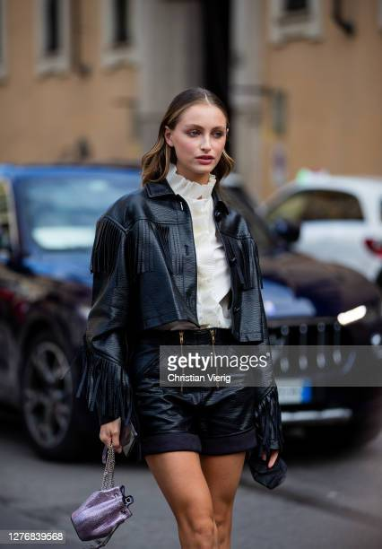 Guest is seen wearing black leather jacket and shorts, pink bag, boots outside Philosophy during the Milan Women's Fashion Week on September 26, 2020...